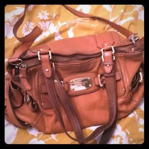 Michael Kors brown leather purse.